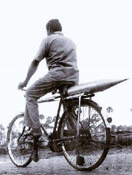 Carrying Rocket Parts on Cycle