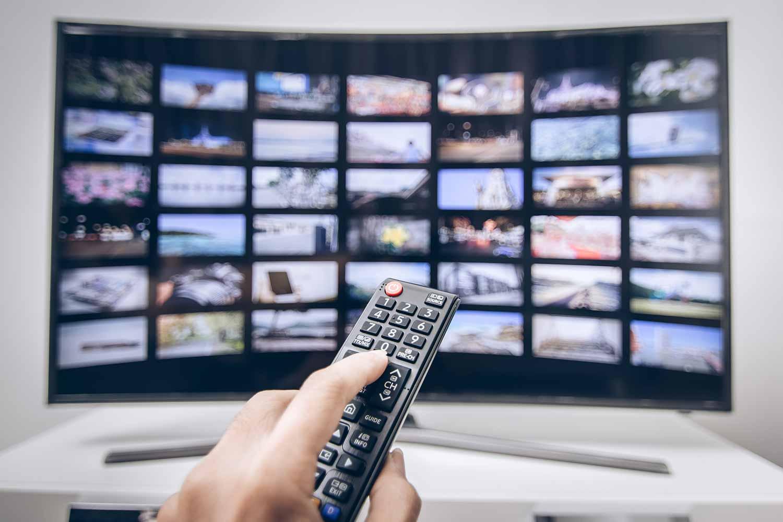 Hand pressing-remote-smart-tv