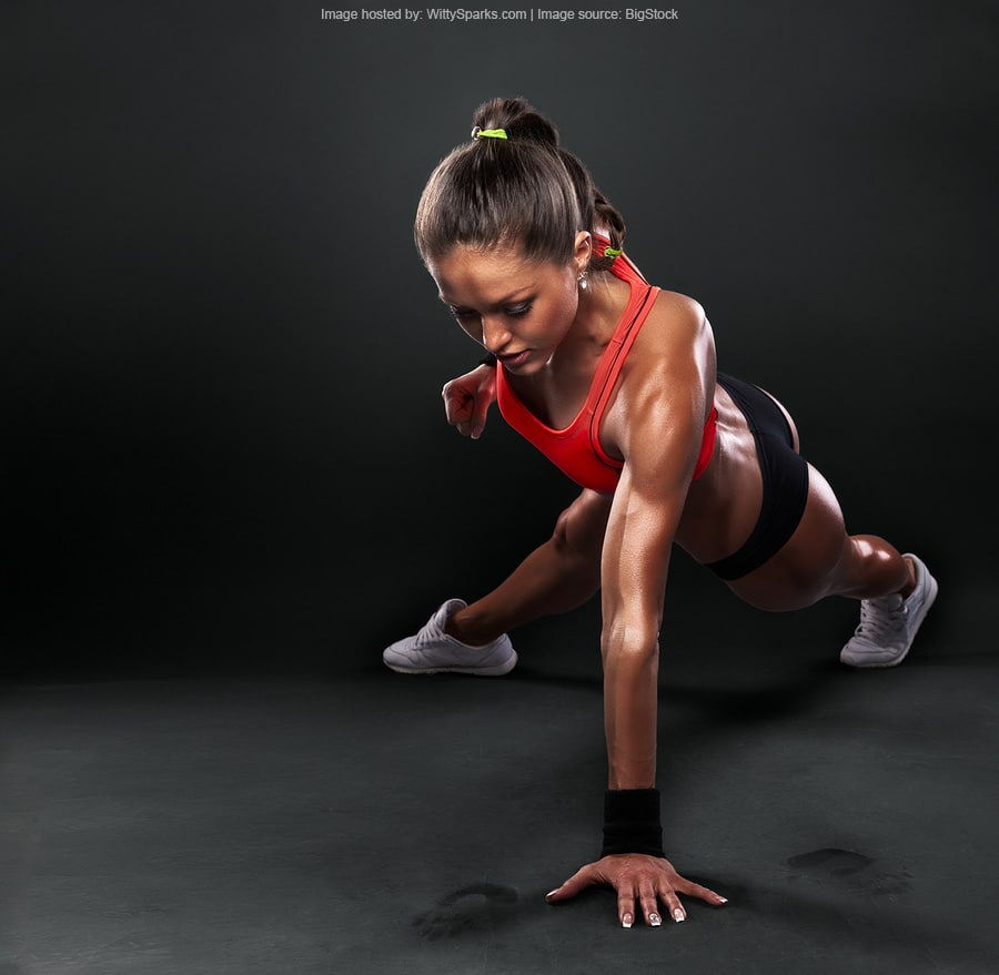 Fitness - Young Woman Doing Push-ups