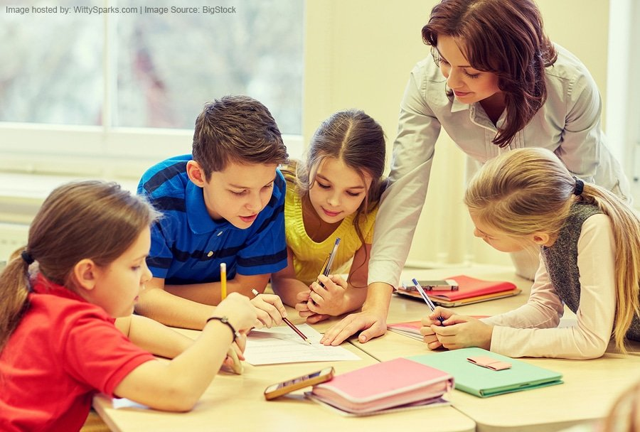 Education, elementary school, learning and people concept - teaching