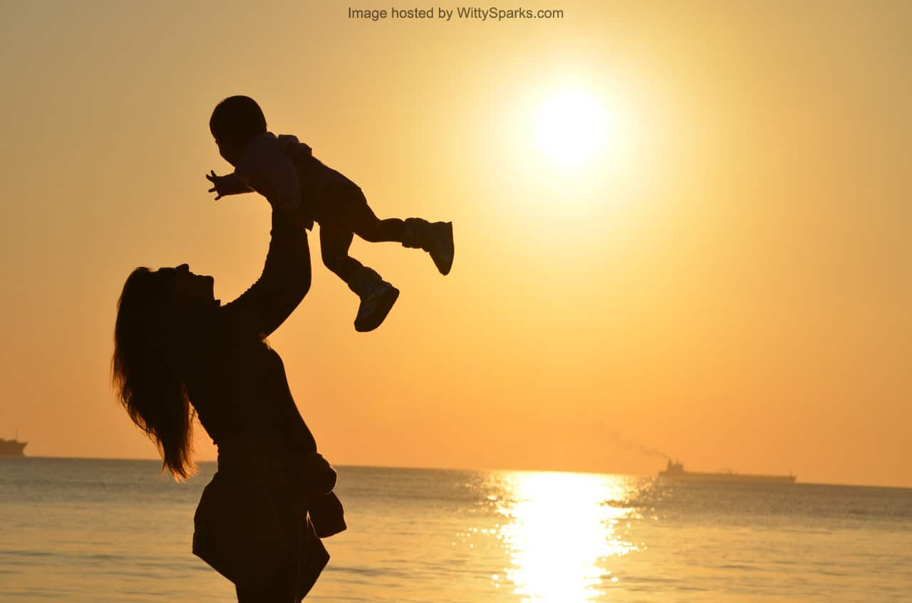 Mother and daughter love in sunset - Mother's Day
