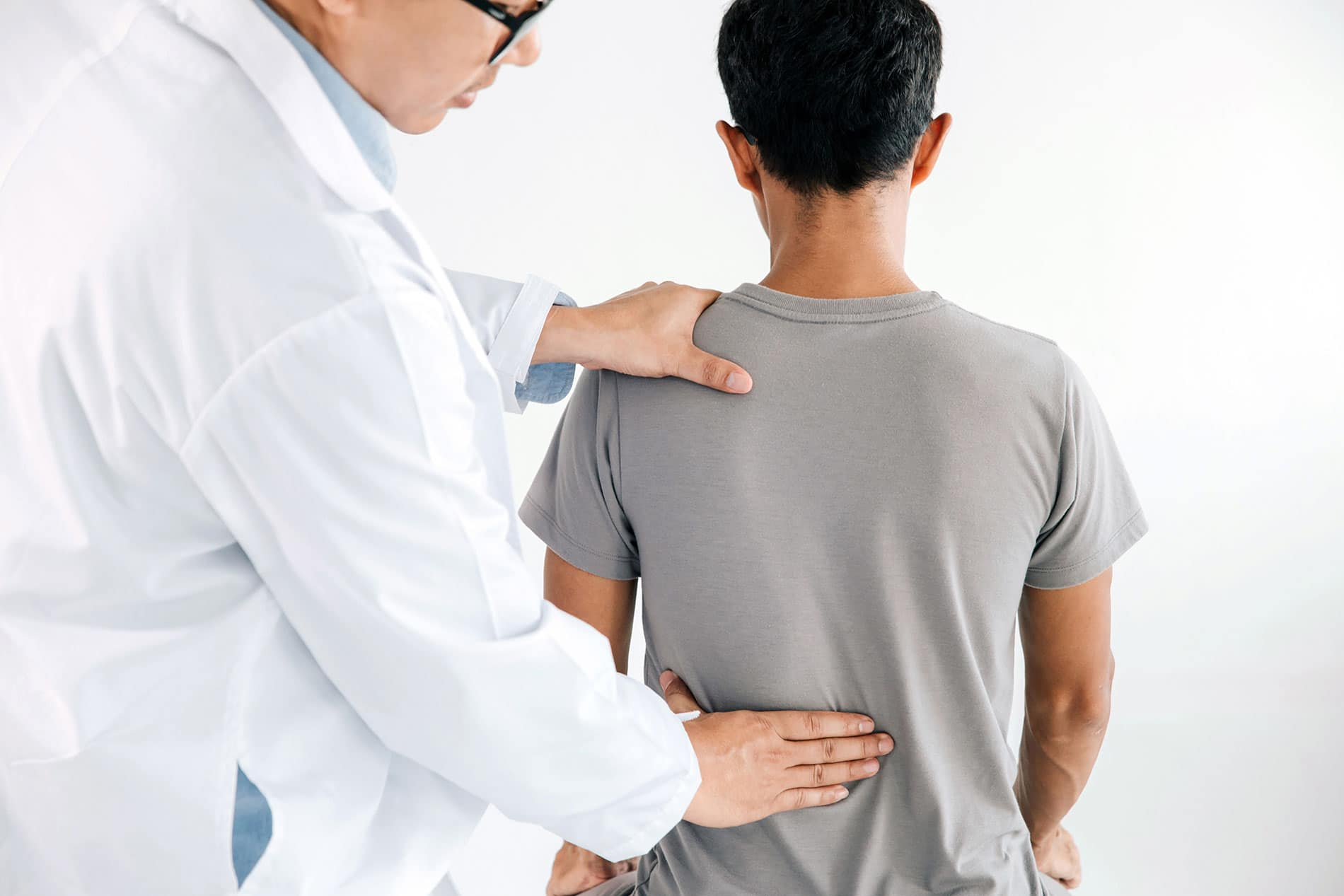 Physiotherapist doing healing chiropractic treatment