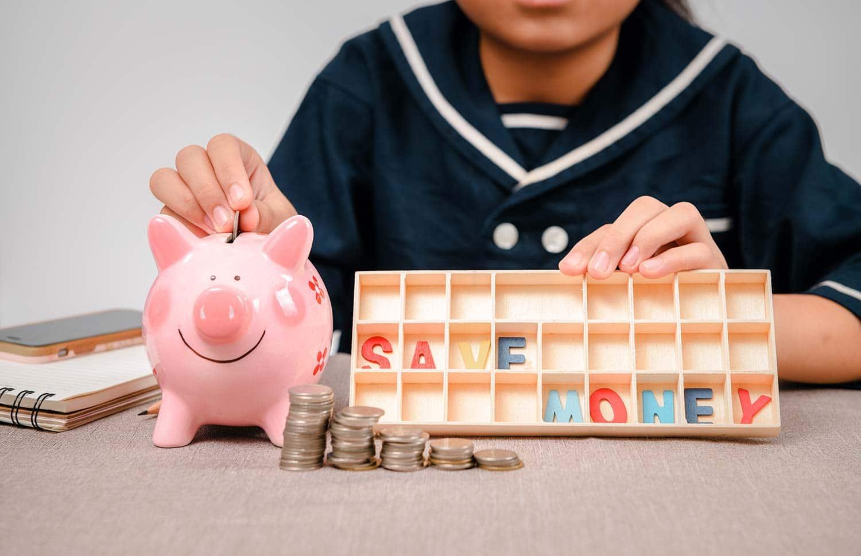 Little girl coin piggy bank - Kids money saving tips