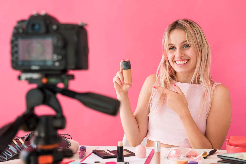 Beauty influencer marketer recording make-up video