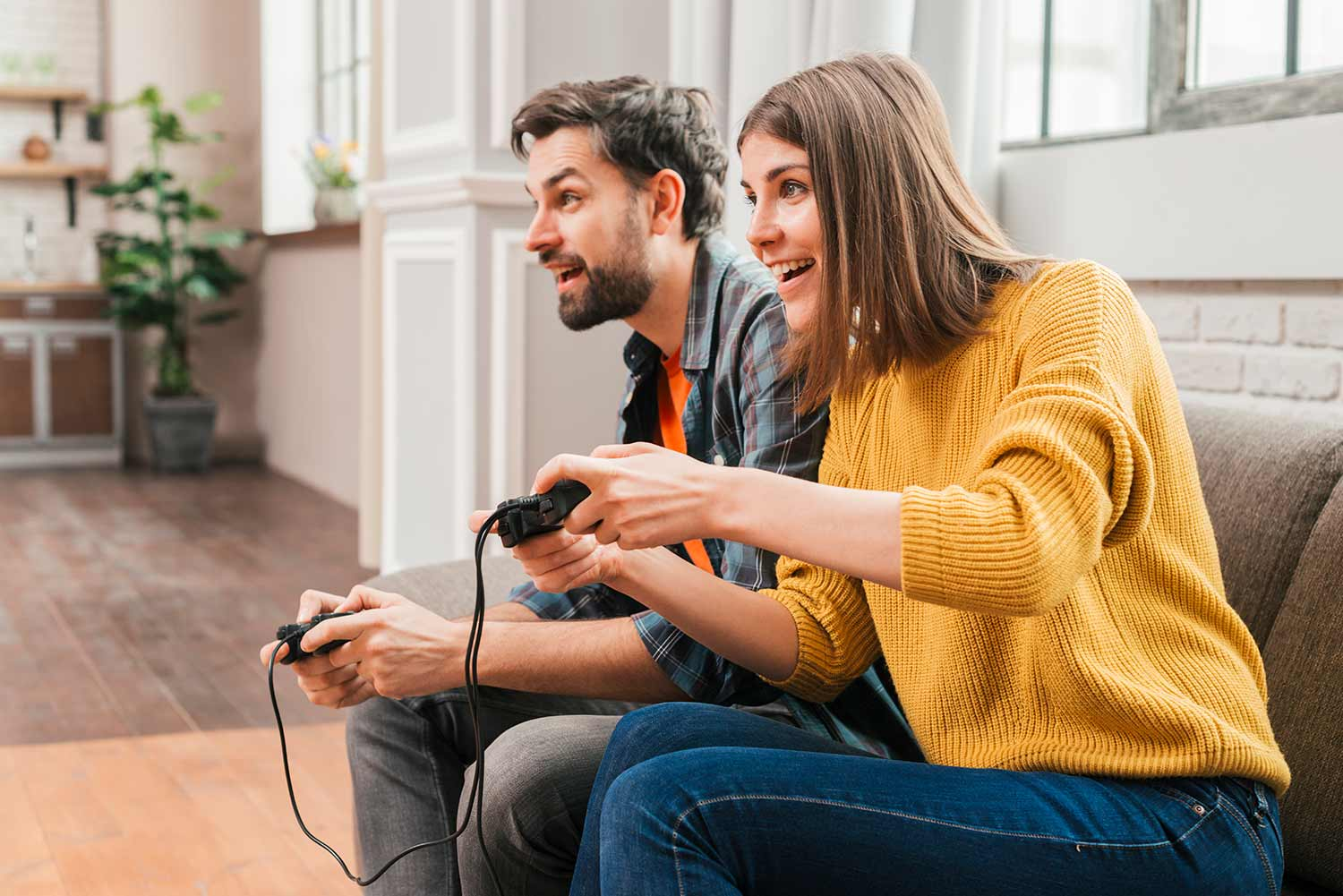 Young couple playing video game on gamer anniversary