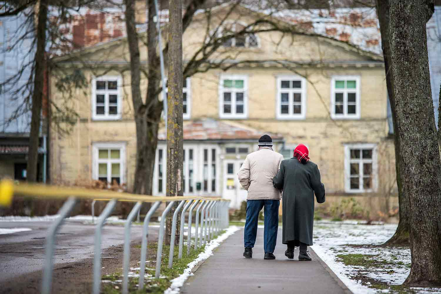 Two elderly people man and woman are walking - final expense insurance