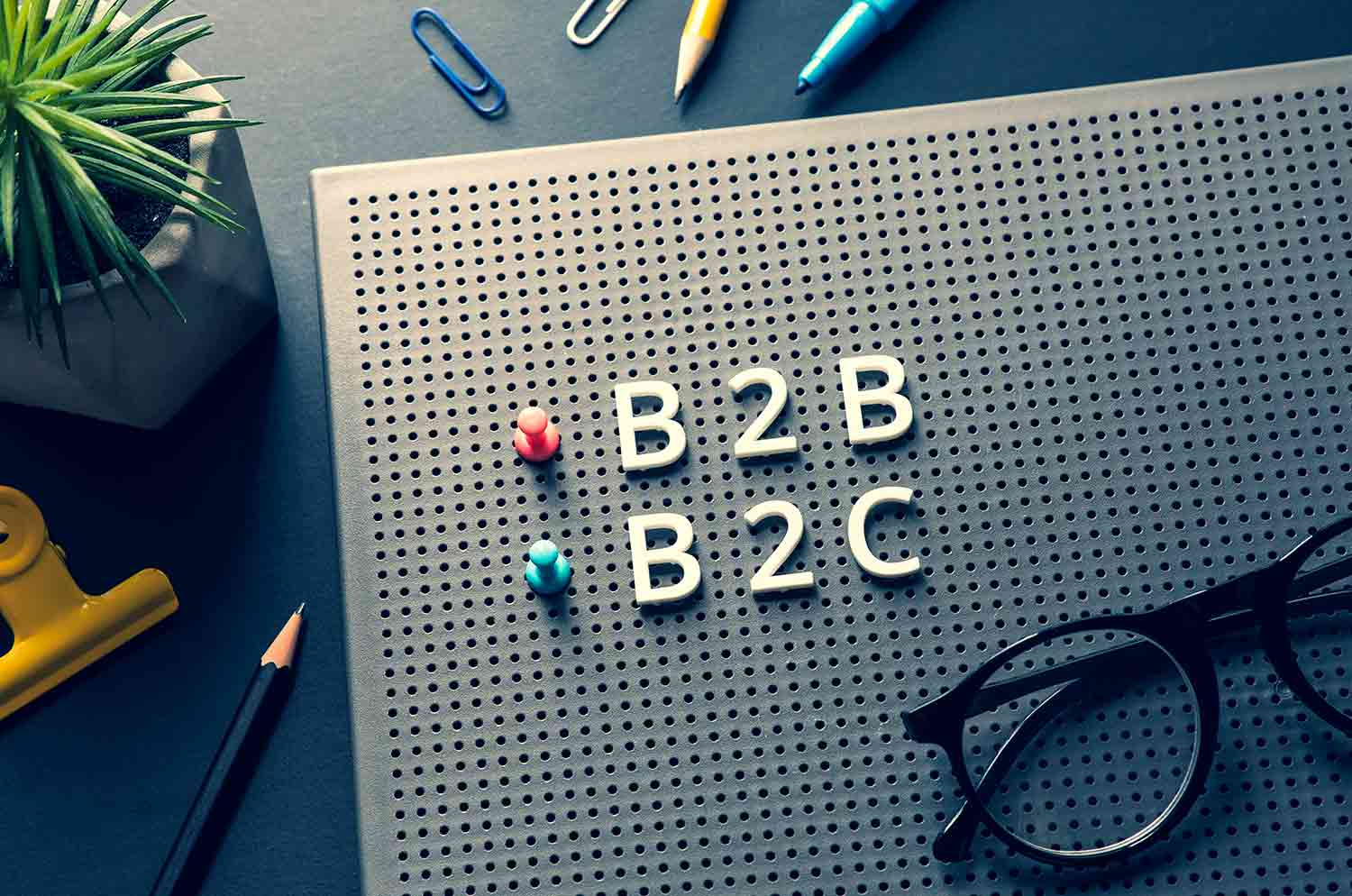 Business marketing with B2B, B2C, C2C text desk table management eCommerce concepts
